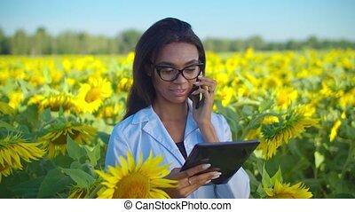 Female agronomist using modern technology in field