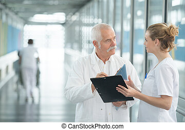 female and male doctor in a corridor