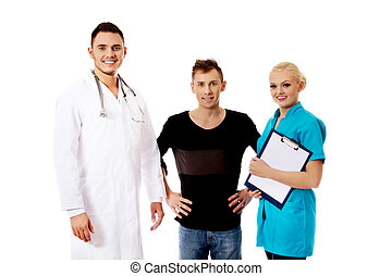 Female and male doctors and patient