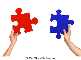 female and male hands holding jigsaw isolated on white...