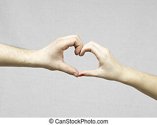 Female and Male Hands Making a Heart Shape