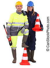 female and male road workers posing together