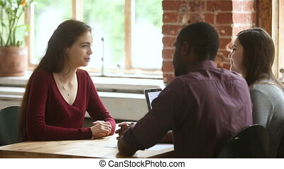 Female applicant talking during job interview with...