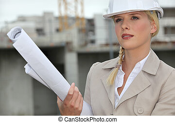 Female architect arriving at construction site