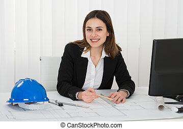 Female Architect Drawing Blueprint
