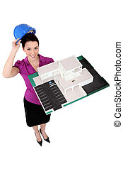 Female architect holding a scale model