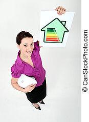 Female architect holding energy rating card