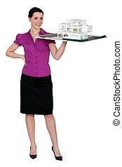 Female architect holding holding scale model of project