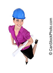 Female architect in hardhat and heels
