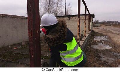 Female Architect inspecting the construction of a building