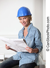Female architect looking at plans
