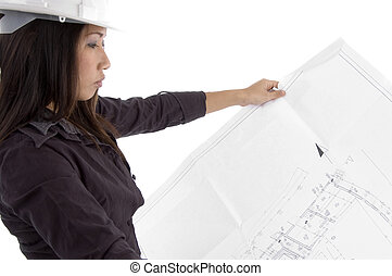 female architect looking blueprints