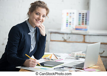 Female architect posing in office