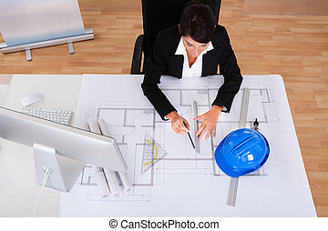 Female Architect With Blue Print
