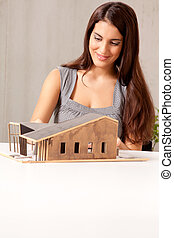 Female Architect with House Model