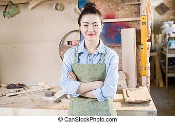 Female Artisan Posing in Workshop