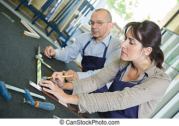 female artisan working on wooden picture frame
