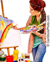Female artist at work. - Artist woman at work near easter on...