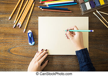 Female artist making a pencil drawing - Point of view of...