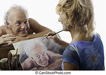 female artist painting a portrait of her man