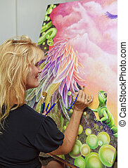 female artist painting with oil on canvas