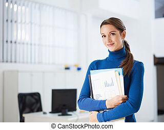 female assistant - business woman holding reports and ...