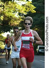 Female athlete racing.