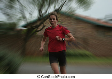 Female athlete running fast.