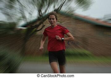 Female athlete running fast.