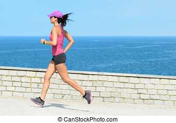 Female athlete running on vacation