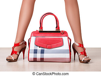 Female bag between beautiful woman's legs in sandals