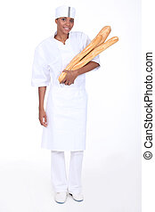 Female baker with loaves of bread