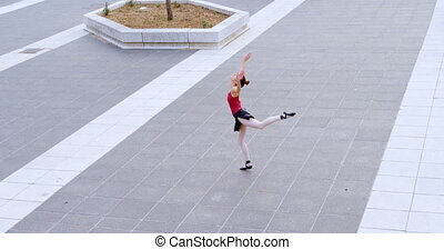 Female ballet dancer performing on pavement 4k - Female...