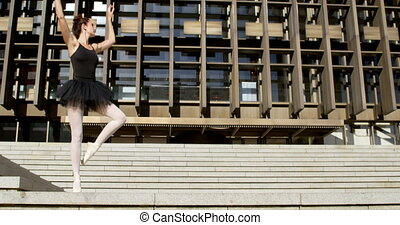 Female ballet dancer performing on stair 4k - Female ballet...