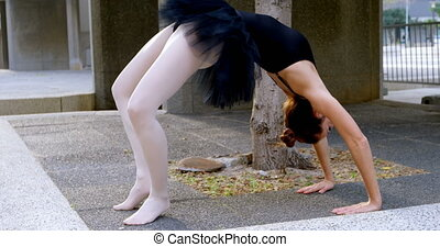 Female ballet dancer stretching before dancing 4k - Female...