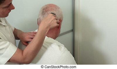 Female barber cutting hair a man with irritated skin
