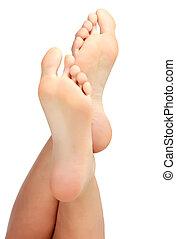Female bare feet on white background