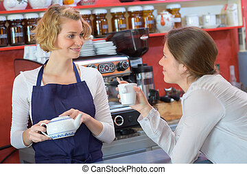 female barista with her nice client