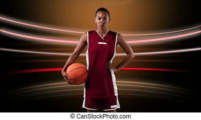 Female basketball player against light trails on black background