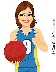 female basketball player holding ball and showing thumbs up...