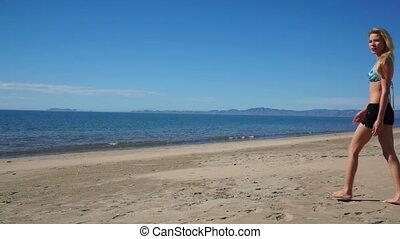 Female Beach Shorts Invite - Woman wearing shorts walking...