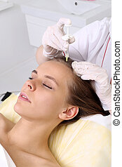 The concept of hair loss. - Female beautician makes...