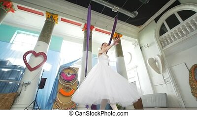 Female beautiful ballerina in white tutu performs pirouette...