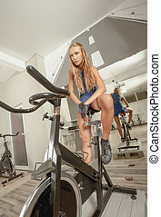 Female Beautiful Young Sexy Gym Cycling