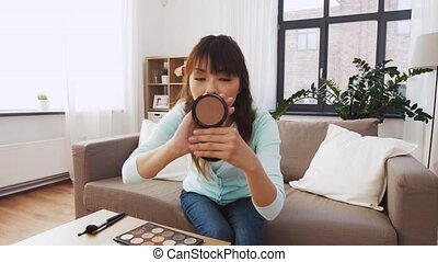 female beauty blogger making video about make up - blogging,...