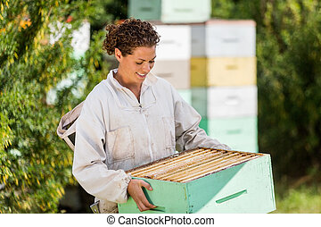 Female Beekeeper In Apiary