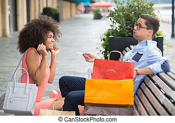 female begging her boyfriend for more shopping