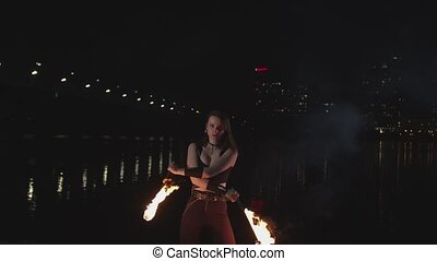 Female bewitching viewer by juggling with torches -...