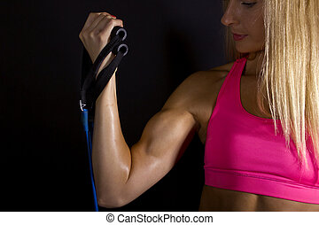 Female Biceps - close up of sweaty and muscular female...