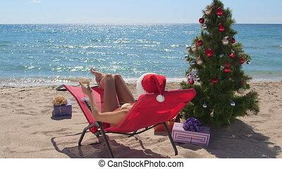 Female bikini Santa Christmas holiday destination